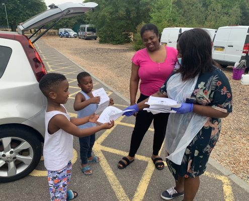 Abena handing out educational worksheets during COVID