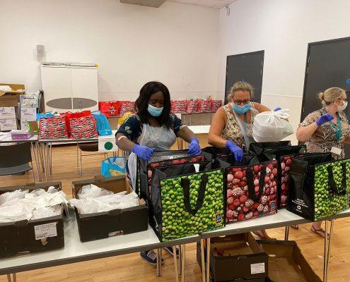 Abena sorting food parcels
